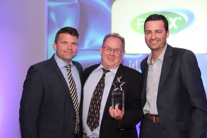 Host Ryan Philpott with Flicx UK MD Richard Beghin and award sponsor Solutions for Sport (Paul Sherratt)