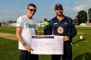 Stefan Vass is presented with his cheque by Steelbacks captain Kyle Coetzer