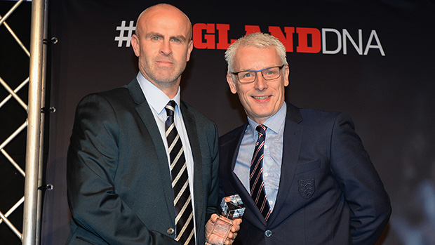 Tony Elliott winner of the Grassroots Disability Coach of the Year award is presented with the trophy by Jeff Davis, National Elite Development Manager (Disability football) during the Annual Conference - FA Coaching Awards at St Georges Park on December 6, 2015 in Burton-upon-Trent, England.  (Photo by Tony Marshall - The FA/The FA via Getty Images)